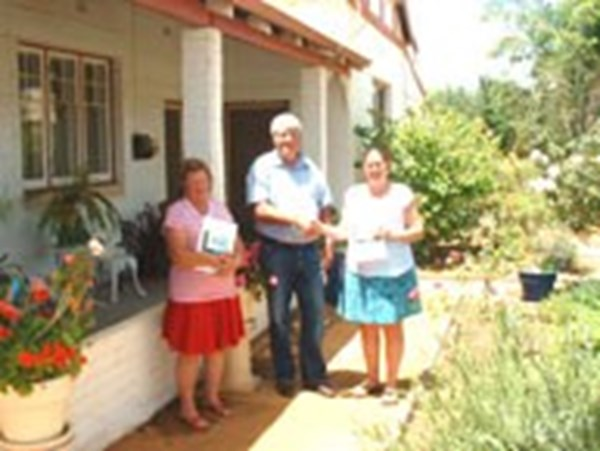 New residents presented with a 'Welcome Pack' by the Past Shire President